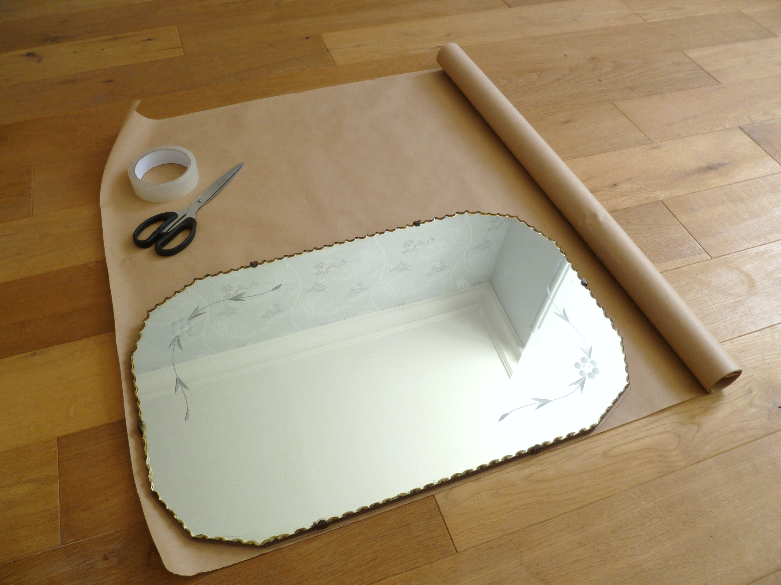 How to hang a display of vintage mirrors decorator 39 s for How to make a mirror wall