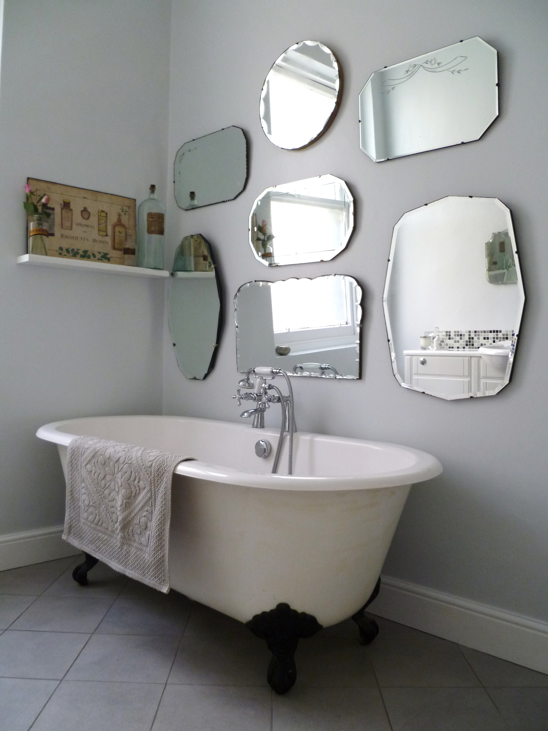 How to hang a display of vintage mirrors decorator 39 s for What to hang on bathroom walls