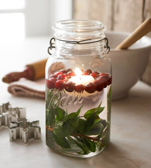 Christmas table centrepiece jar with floating candle
