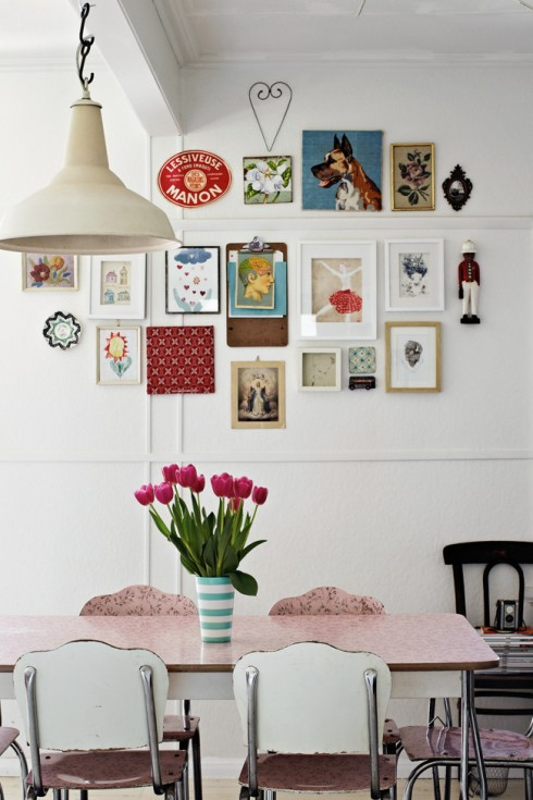 wall of pictures and retro dining table