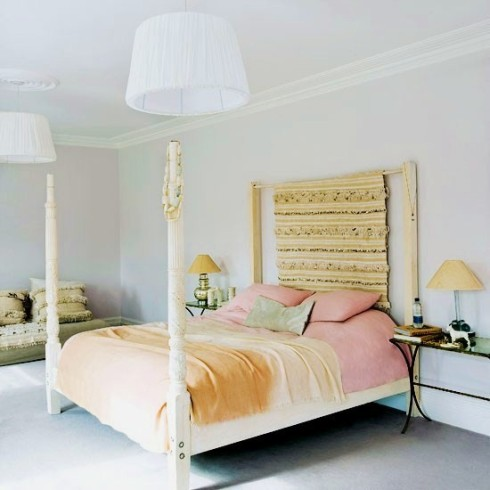 feminine pastel bedroom with four poster bed