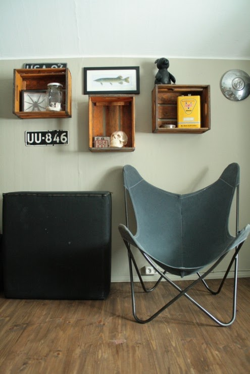 vintage wooden crates as wall display storage