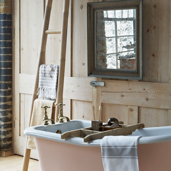 panelled country bathroom with pink slipper bath