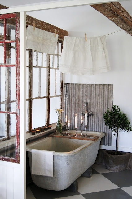 old zinc bathtub and corrugated iron splashback
