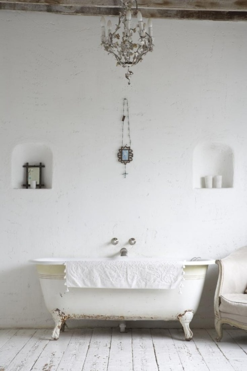 luxury white bathroom with freestanding bath