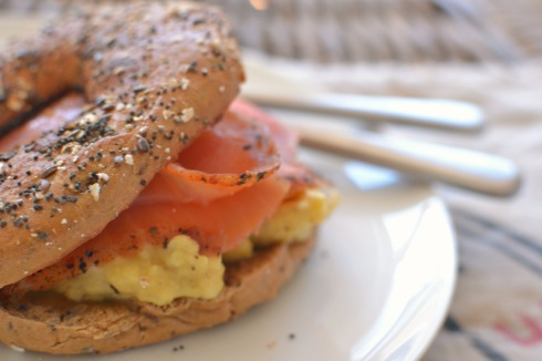seeded bagel with smoked salmon and scrambled eggs