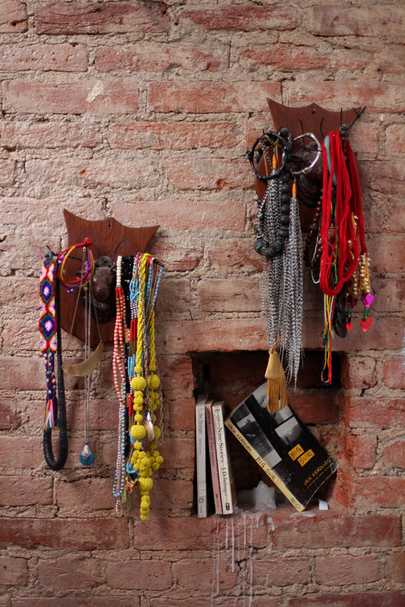 jewellery-brick-wall-books-shelf