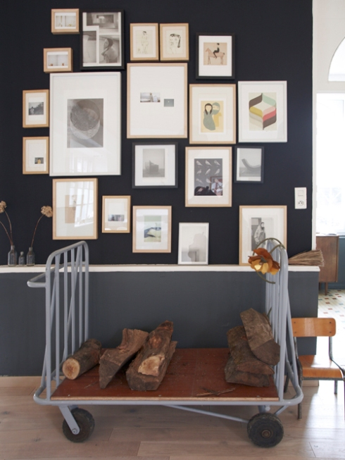 dark grey wall with picture frames
