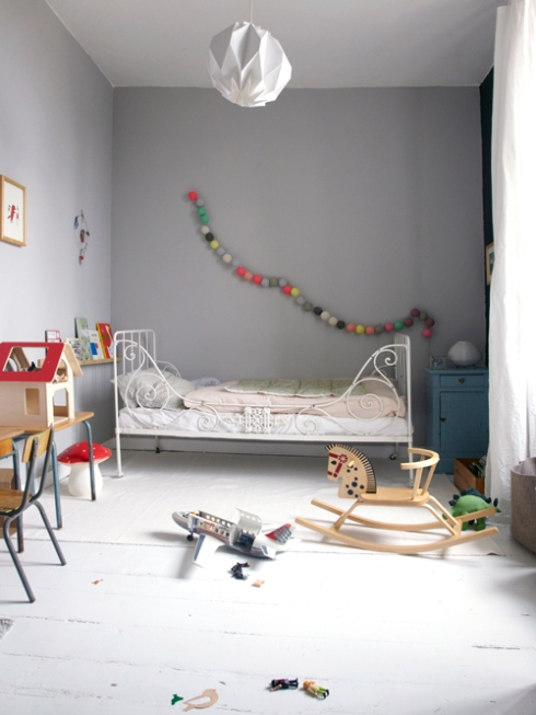 grey child's bedroom with string lights