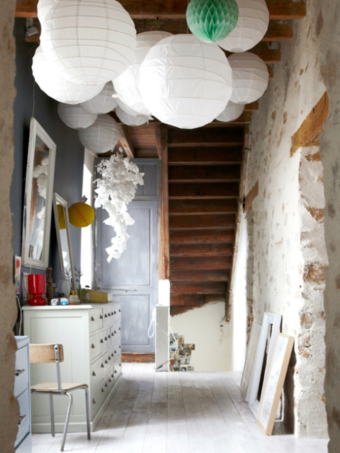 rustic hallway with paper light shades