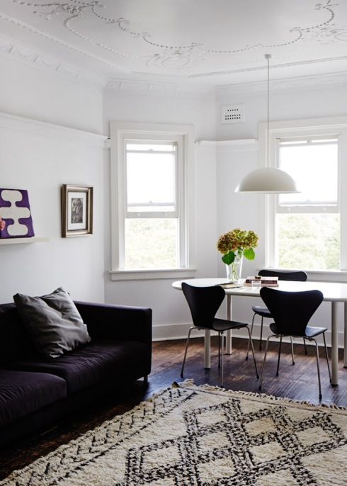 white dining room with deep pile rug