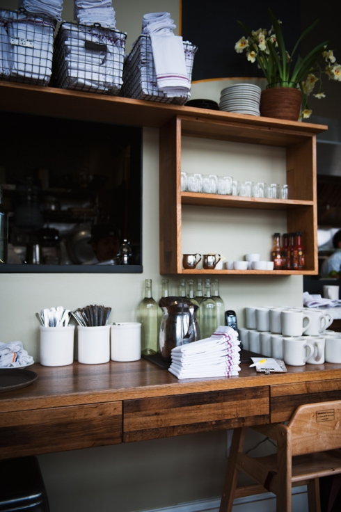 shelves with cutlery and crockery