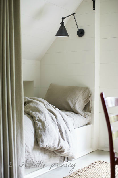 bedroom sleeping nook with curtain