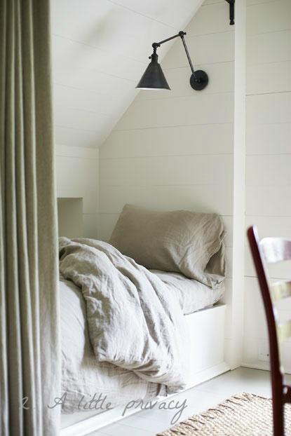 bedroom sleeping nook with curtain