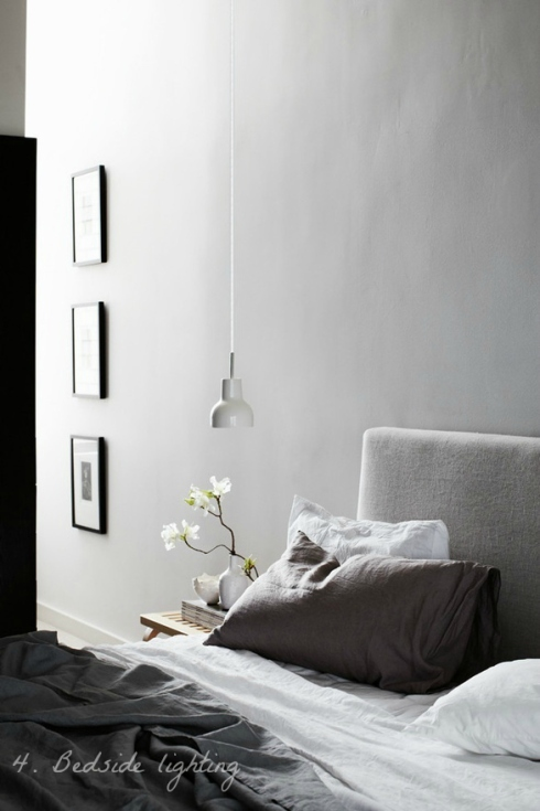 calm grey bedroom with hanging bedside light