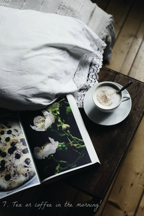 cup of coffee and magazine beside bed