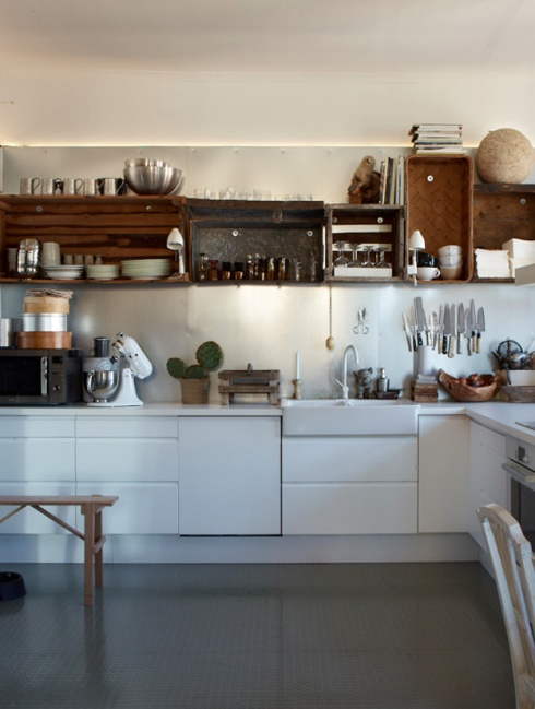 white kitchen with open shelves made from crates