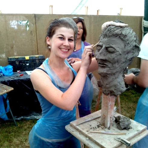 sculpting heads from clay art in action