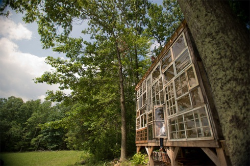 exterior of glass house made from old windows