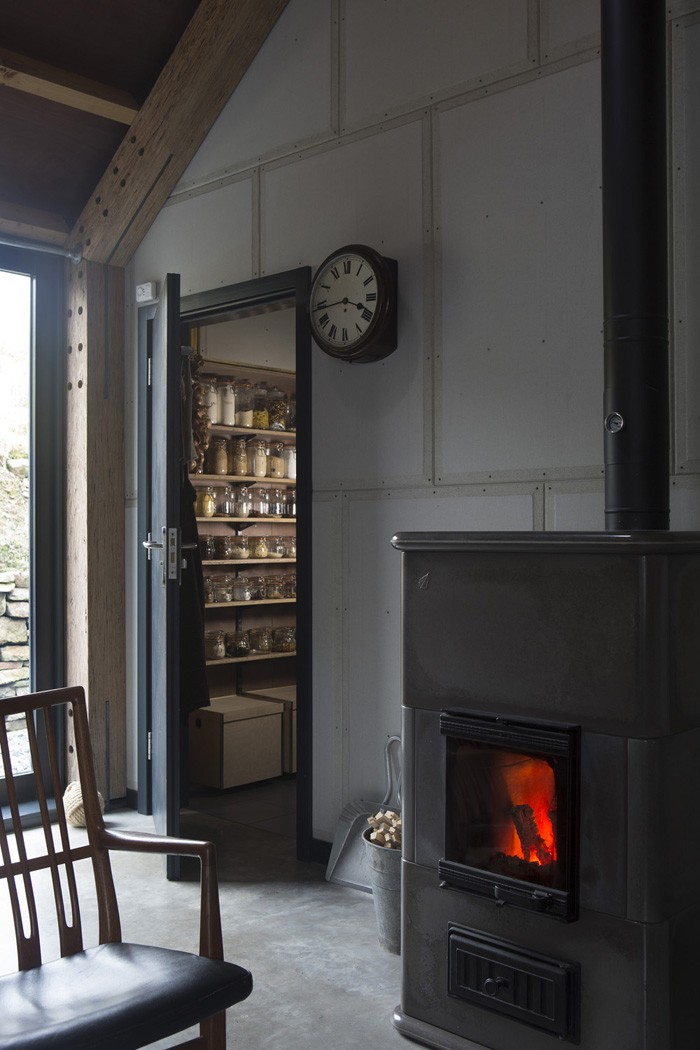 Dutch woodburner and pantry - Decorator's Notebook blog via Remodelista