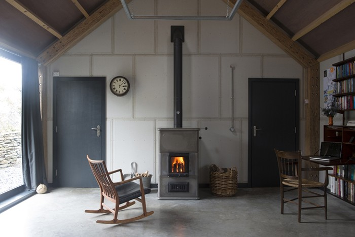 modern barn interior with woodburner - Decorator's Notebook blog via Remodelista
