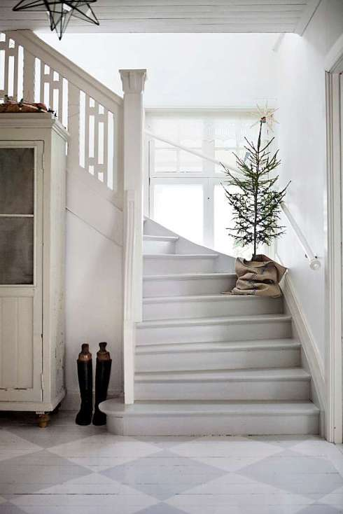 hallway with small Christmas tree
