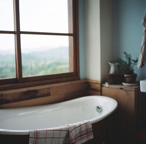 country style bathroom blue wall slipper tub