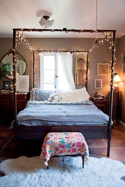 four poster bed with fairy lights