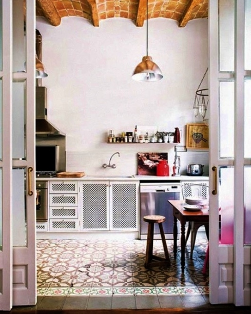 bohemian kitchen with colourful patterned floor tiles
