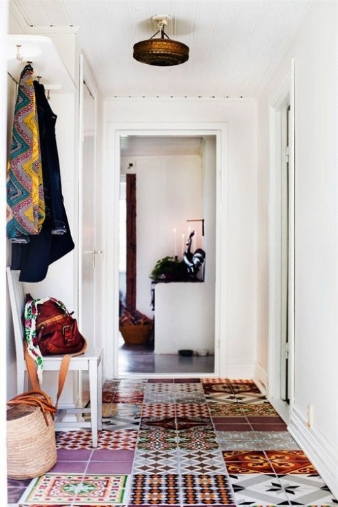 patchwork patterned floor tiles in hallway